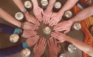 Our mission - partners gathered with hands in a circle